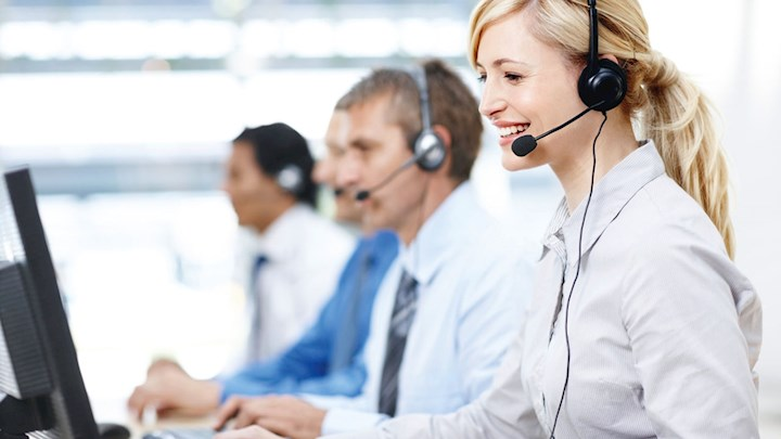 Employees with headsets answering calls from customers